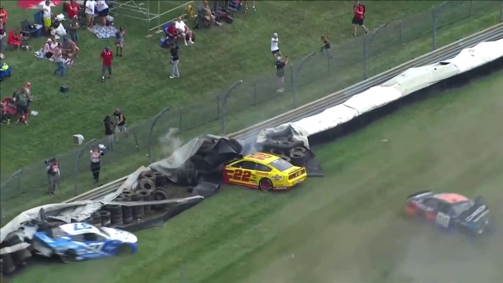 Wild wreck at the Indy with five laps remaining caused by curb in turn six